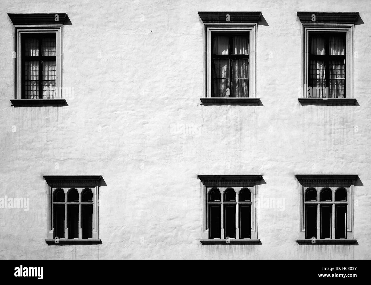 windows black and white in uneven row - Stock Image
