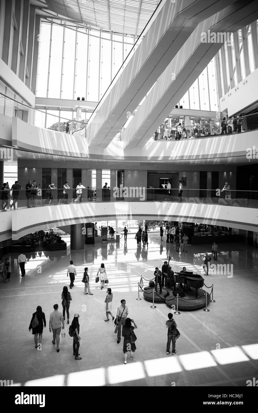 A busy scene of the local Hong Kong Shopping arcade in black and white image. - Stock Image