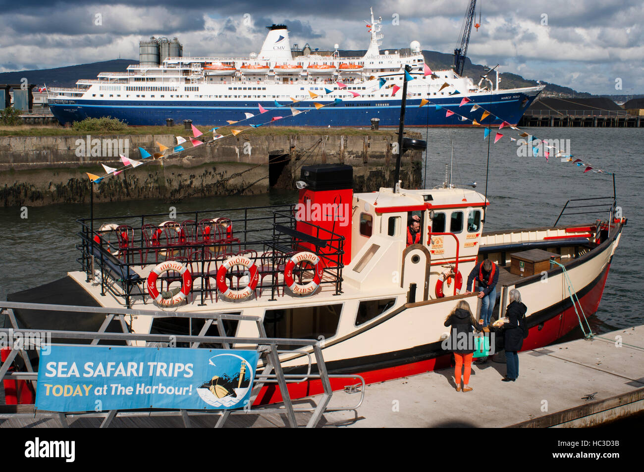 The Red Hulled Tourist Boat Mona Moored in The River Lagan in Belfast Northern Ireland United Kingdom UK. The Lagan - Stock Image