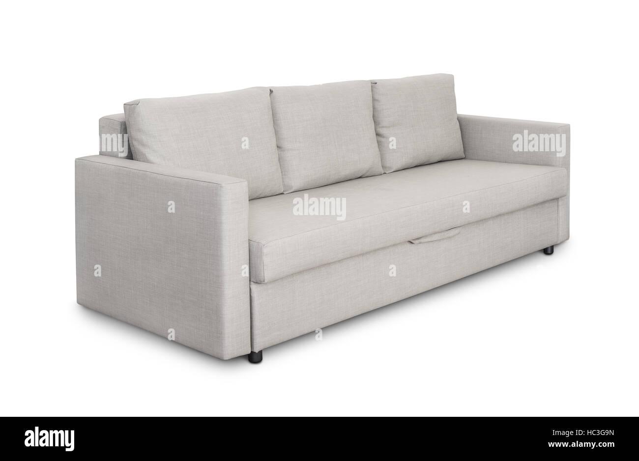 Three seats cozy grey sofa isolated on white - Stock Image