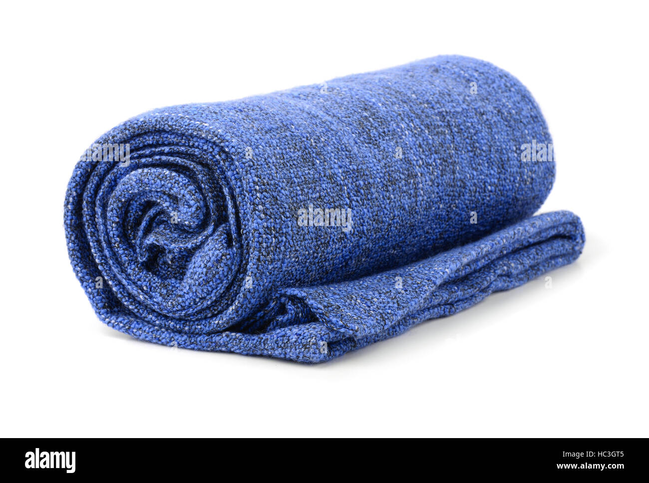 Blue rolled blanket isolated on white - Stock Image