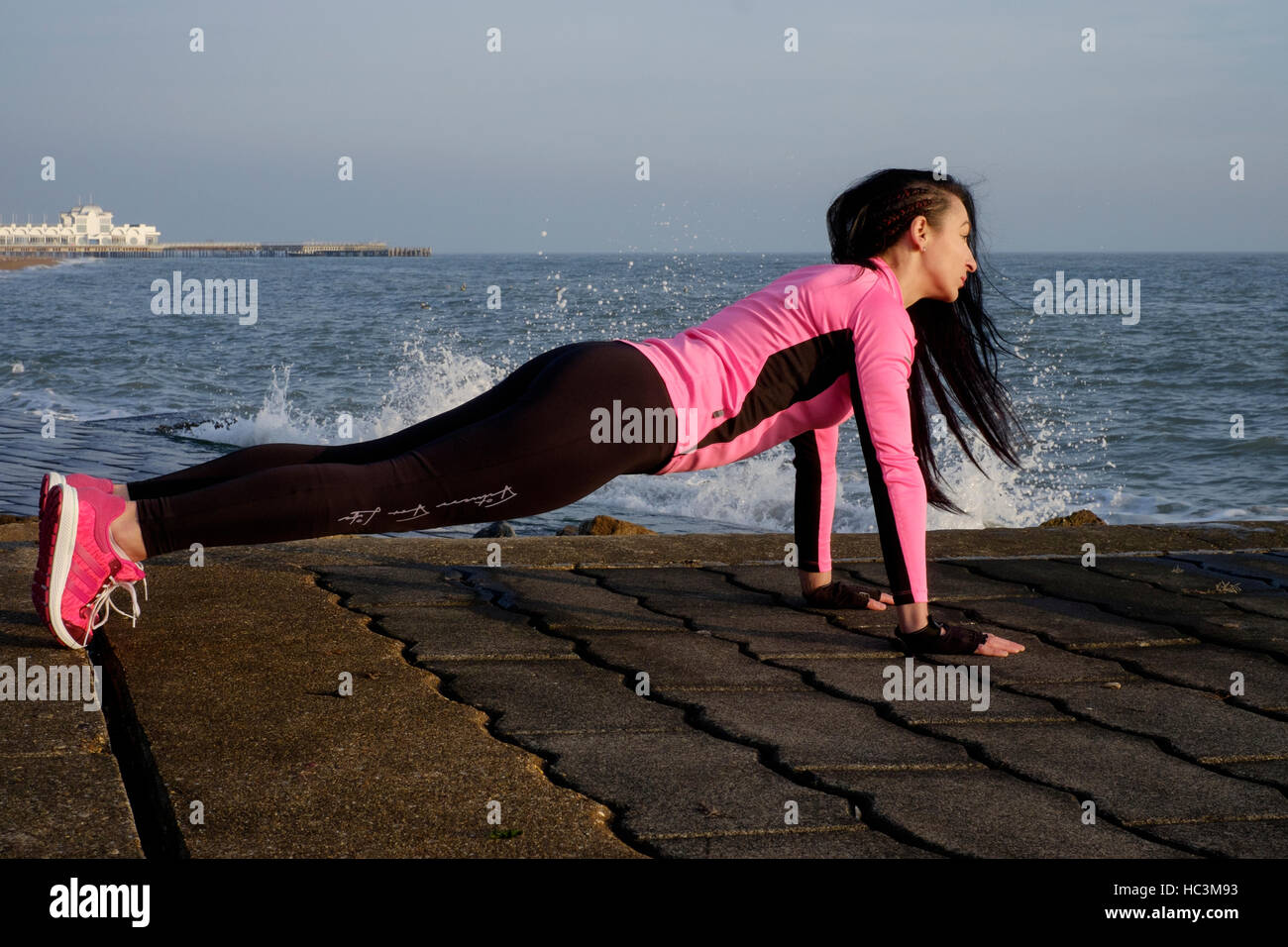 a young female exercising during her daily keep fit routine