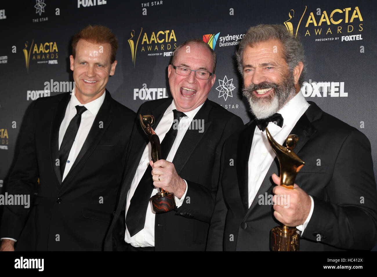 Sydney, Australia. 7 December 2016. Pictured, L-R: Paul Currie, Bruce Davey and Mel Gibson from the movie Hacksaw - Stock Image