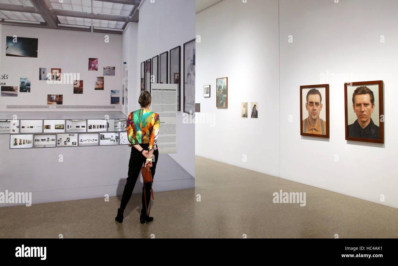 Essen, Germany. 8th Dec, 2016. A visitor looks at photos from the 1980s at the Folkwang Museum in Essen, Germany, - Stock Image