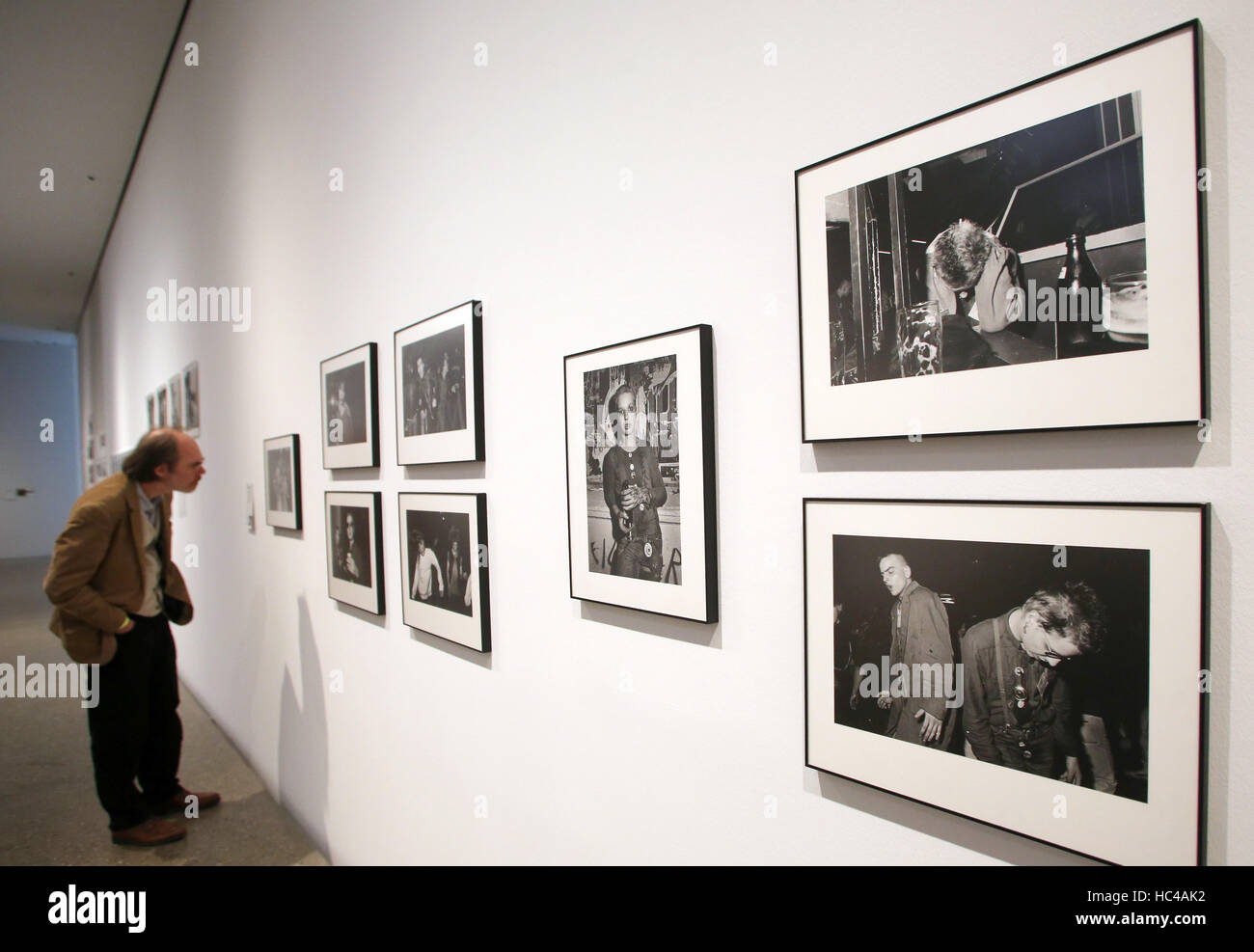 Essen, Germany. 8th Dec, 2016. A visitor looks at photos by Uschi Blume at the Folkwang Museum in Essen, Germany, - Stock Image