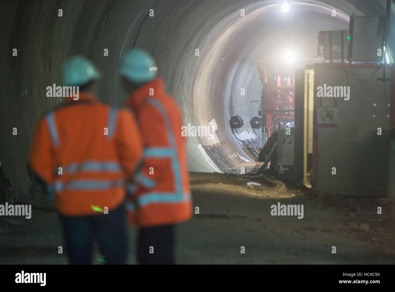 Stuttgart, Germany. 08th Dec, 2016. Construction workers in a tunnel during a tour of the building site where a Stock Photo