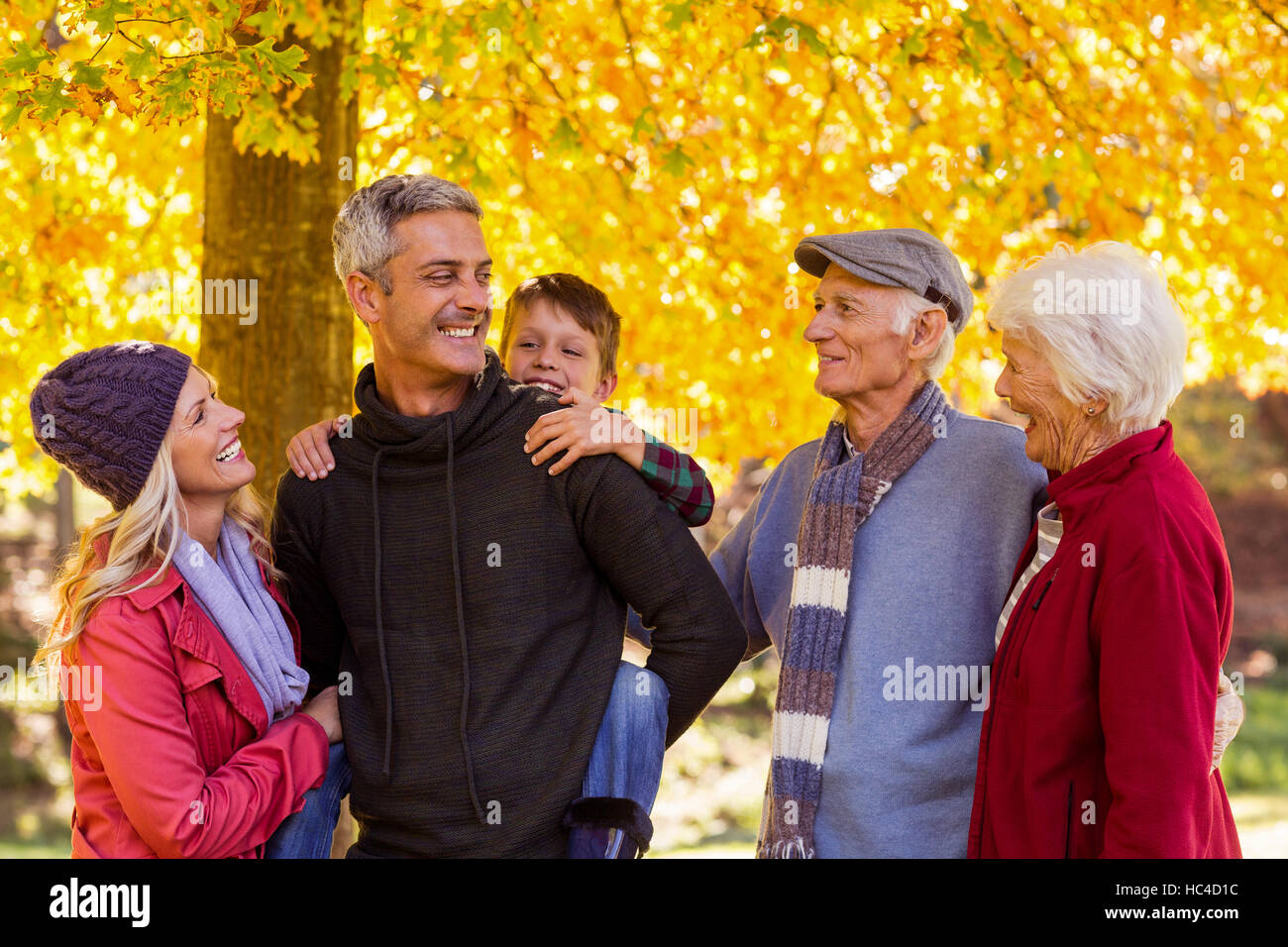 Happy multi-generation family standing at park - Stock Image