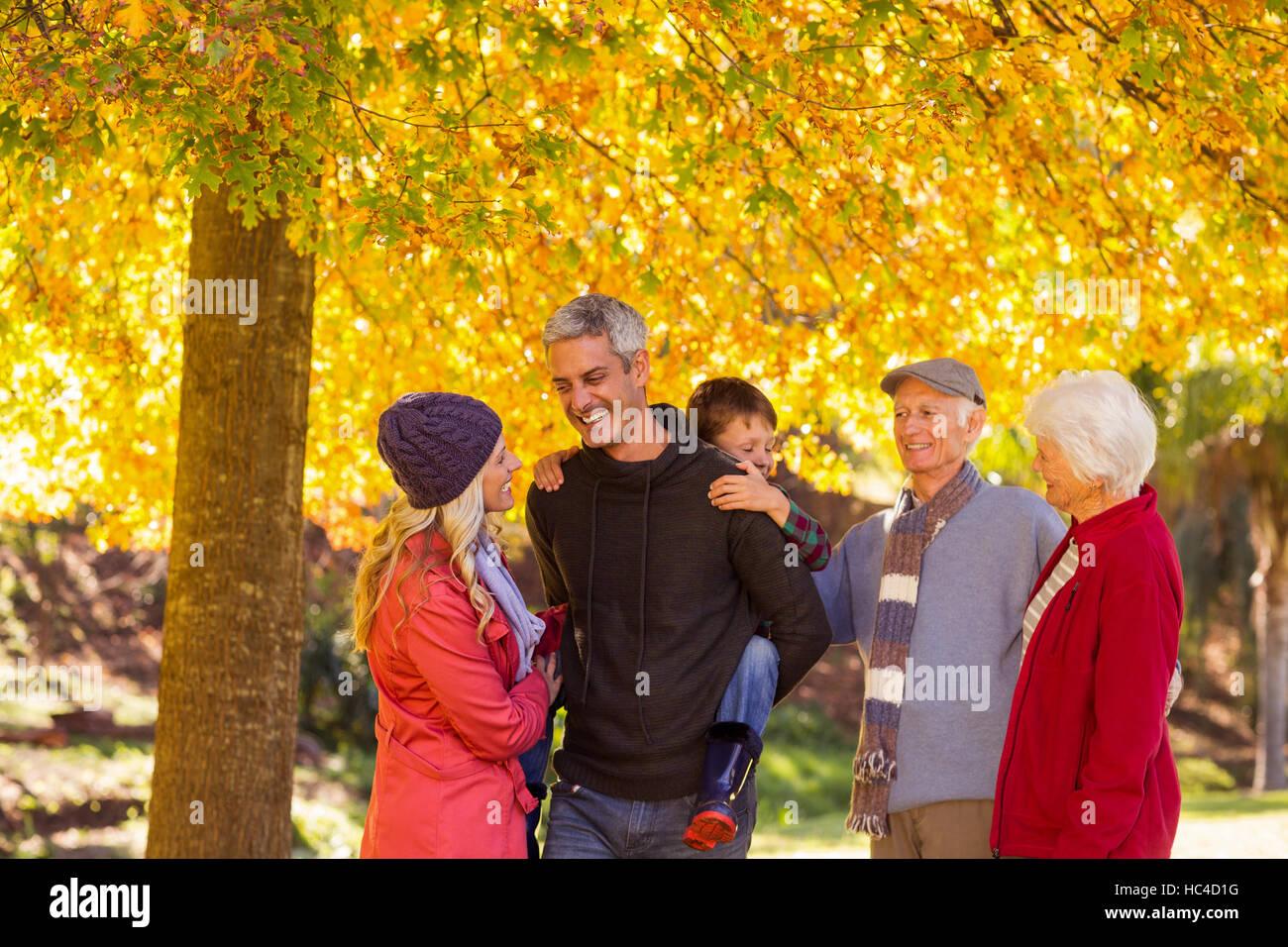 Multi-generation family enjoying at park - Stock Image