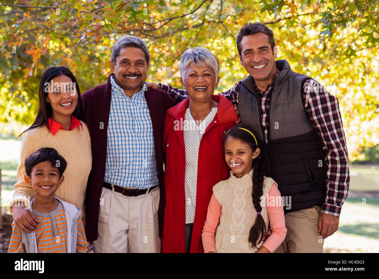 Portrait of multi-generation family standing at park - Stock Image