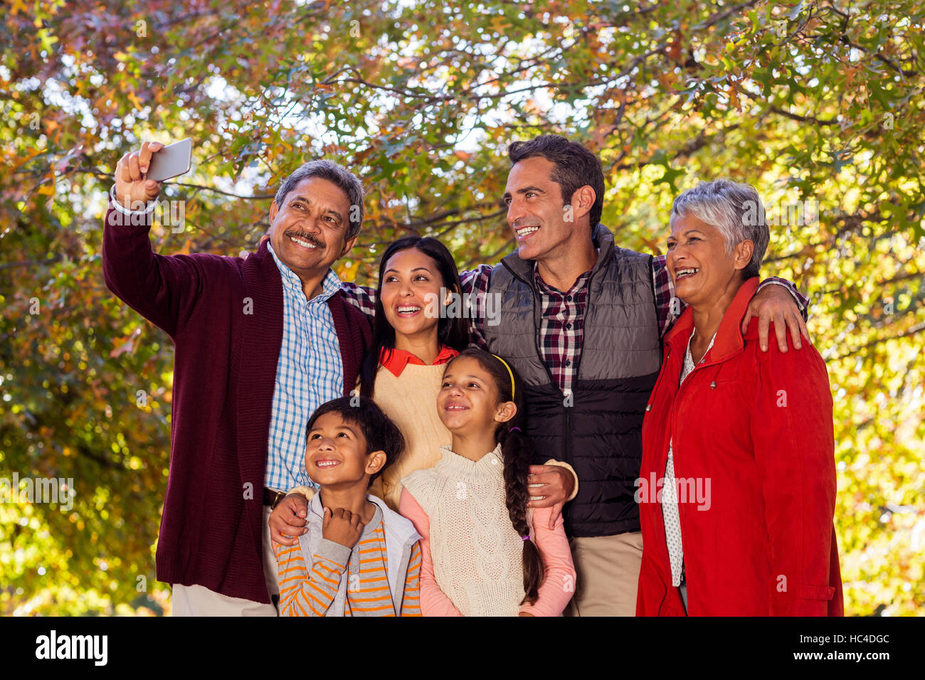 Multi-generation family taking selfie at park Stock Photo