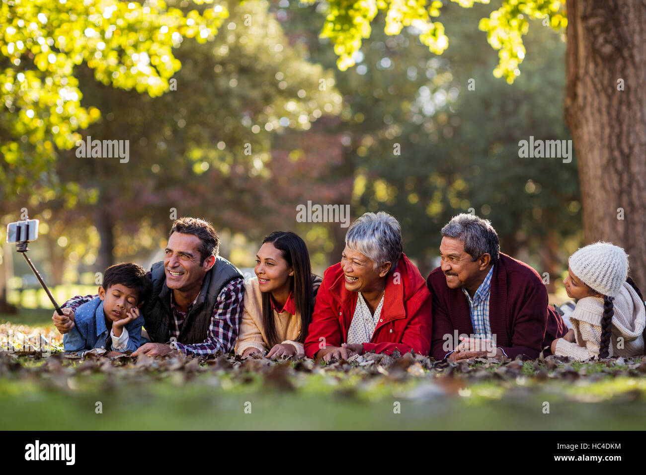 Man with happy family taking selfie - Stock Image