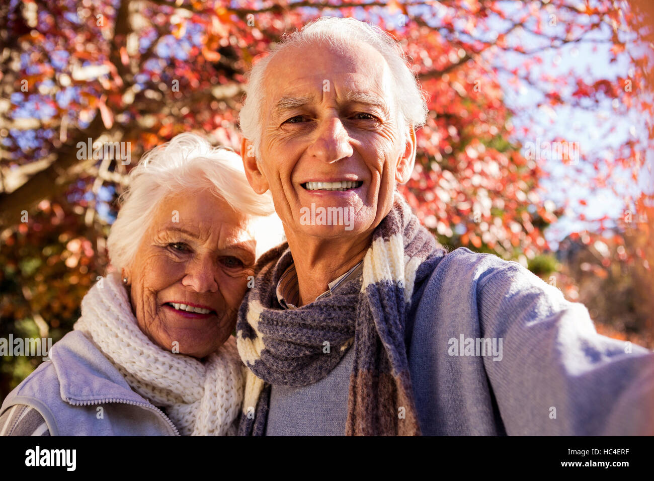 Senior couple taking a selfie - Stock Image