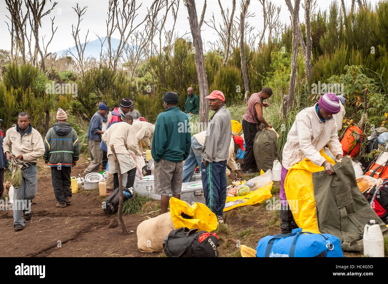 Porters packing up camp, Machame Route, Kilimanjaro, Tanzania - Stock Image