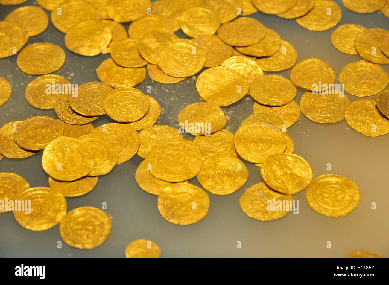 A display of part of the gold coin hoard of gold coins from the Fatimid period (eleventh century CE) in the ancient - Stock Image