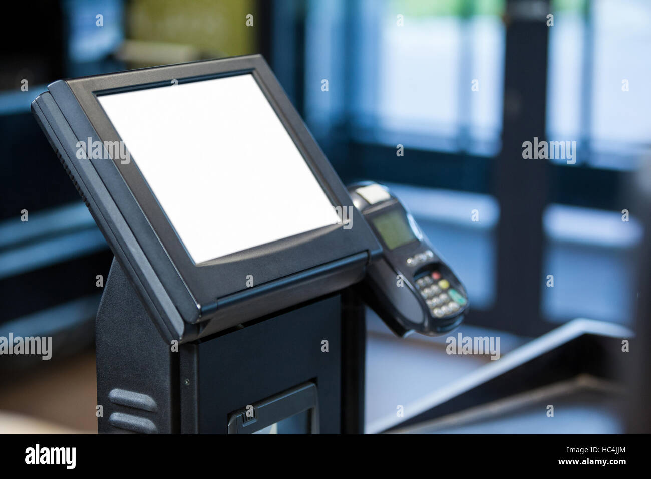 Billing machine and credit card terminal at cash counter - Stock Image