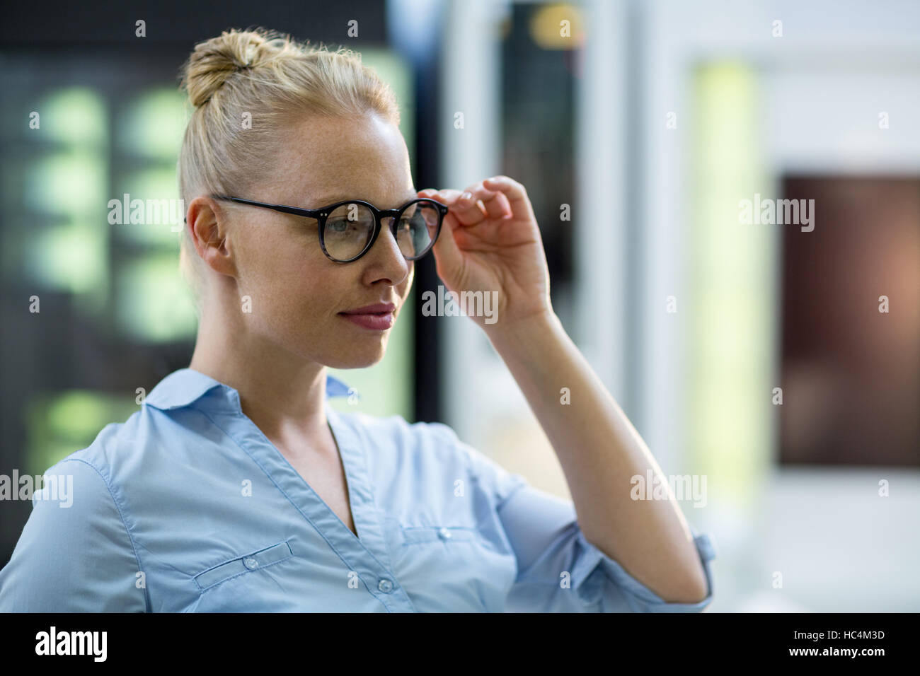 Female customer trying spectacle - Stock Image