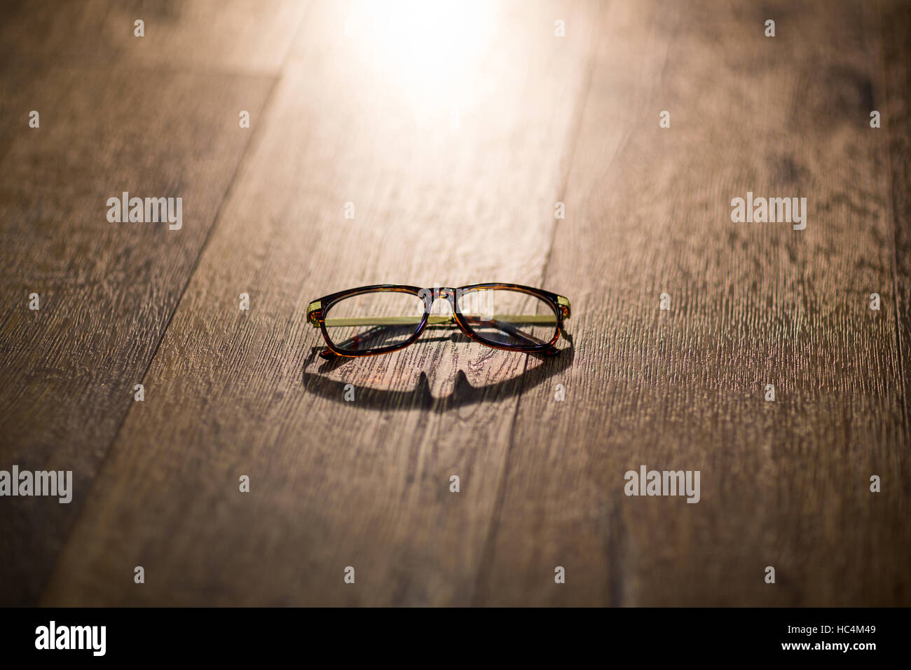 Spectacles on wooden table - Stock Image