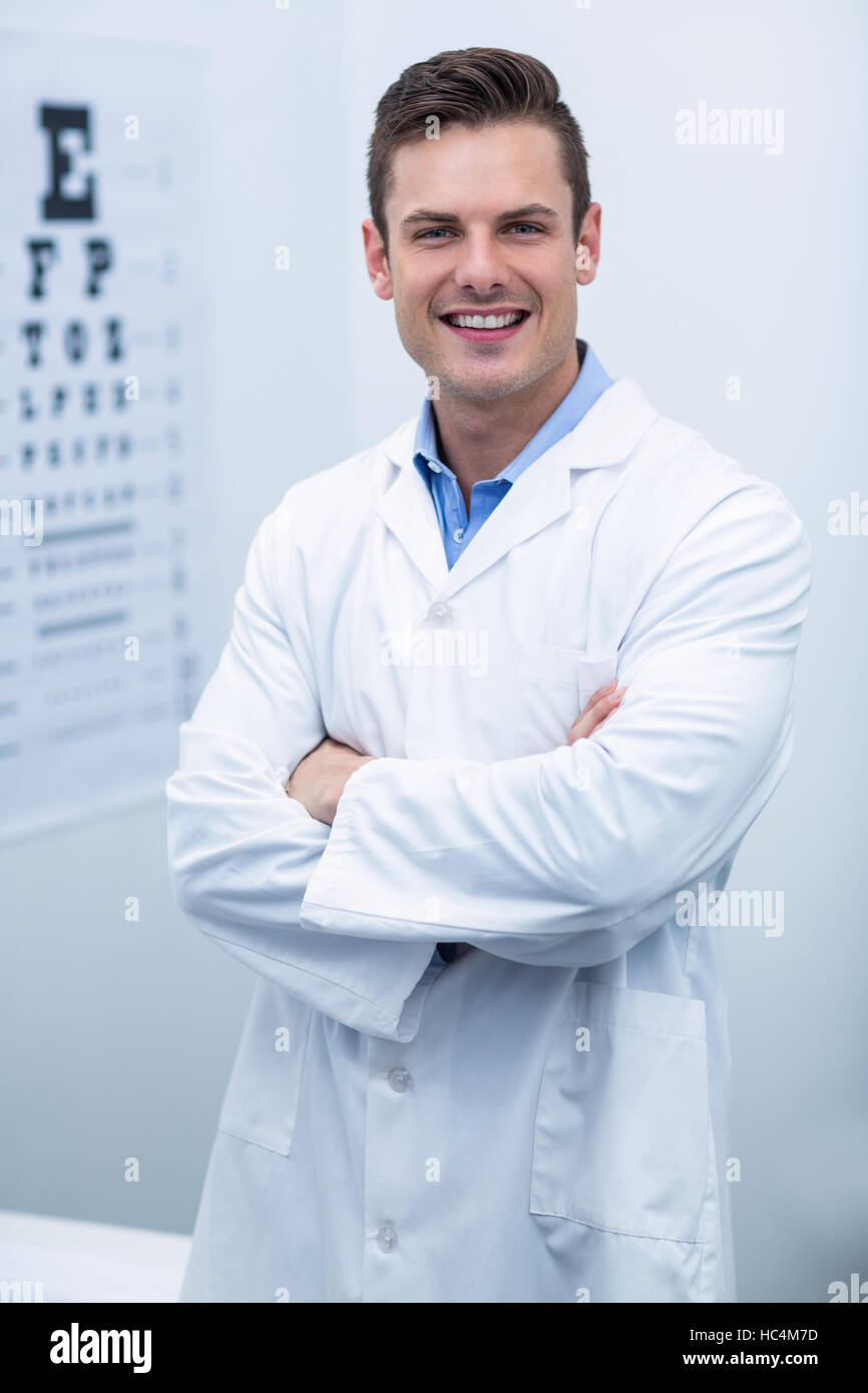 Optometrist standing in ophthalmology clinic - Stock Image