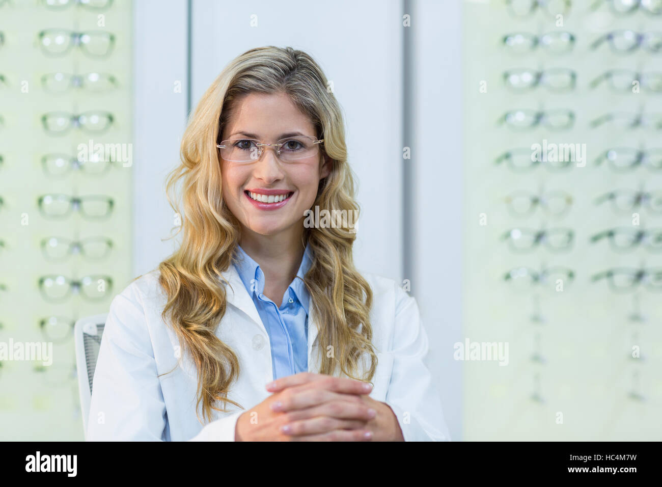 Female optometrist in ophthalmology clinic - Stock Image