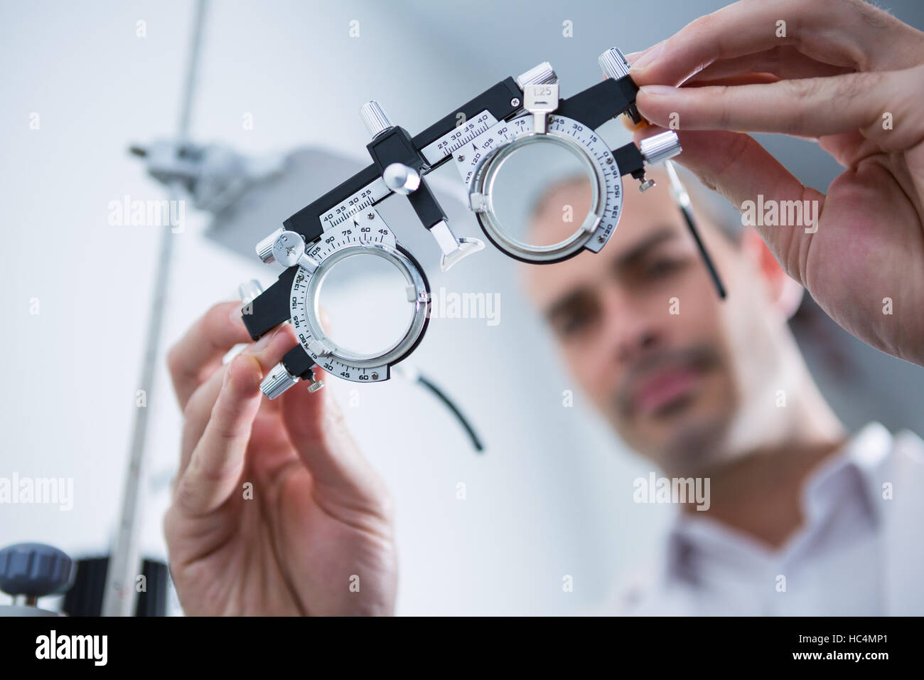 Close-up of optometrist holding messbrille - Stock Image