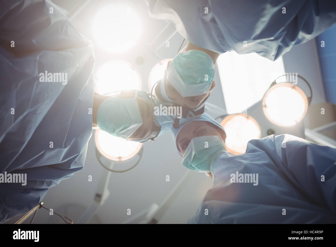 Surgeons performing operation in operation room - Stock Image