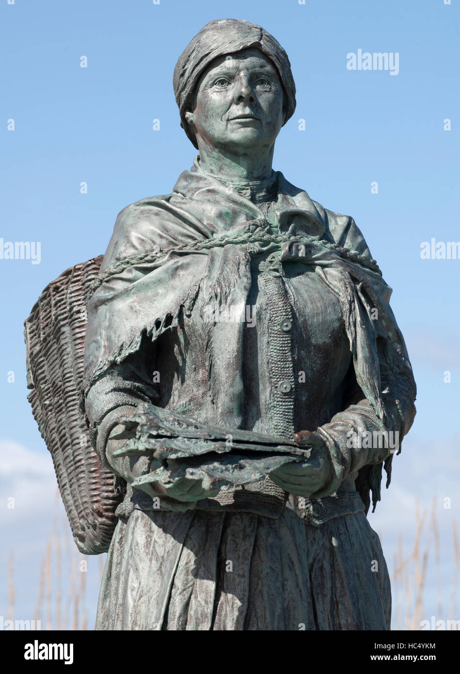 Statue of a Nairn fishwife in the harbour at Nairn, Moray Firth, Highland, Scotland, UK. - Stock Image