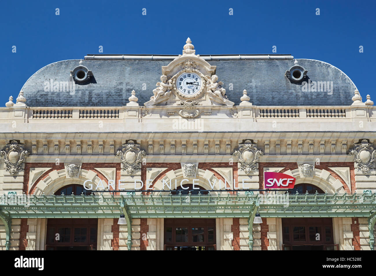 Panorama of the railway station in the center, sunny day, blue sky, a lot of tourists, the area in front of the - Stock Image