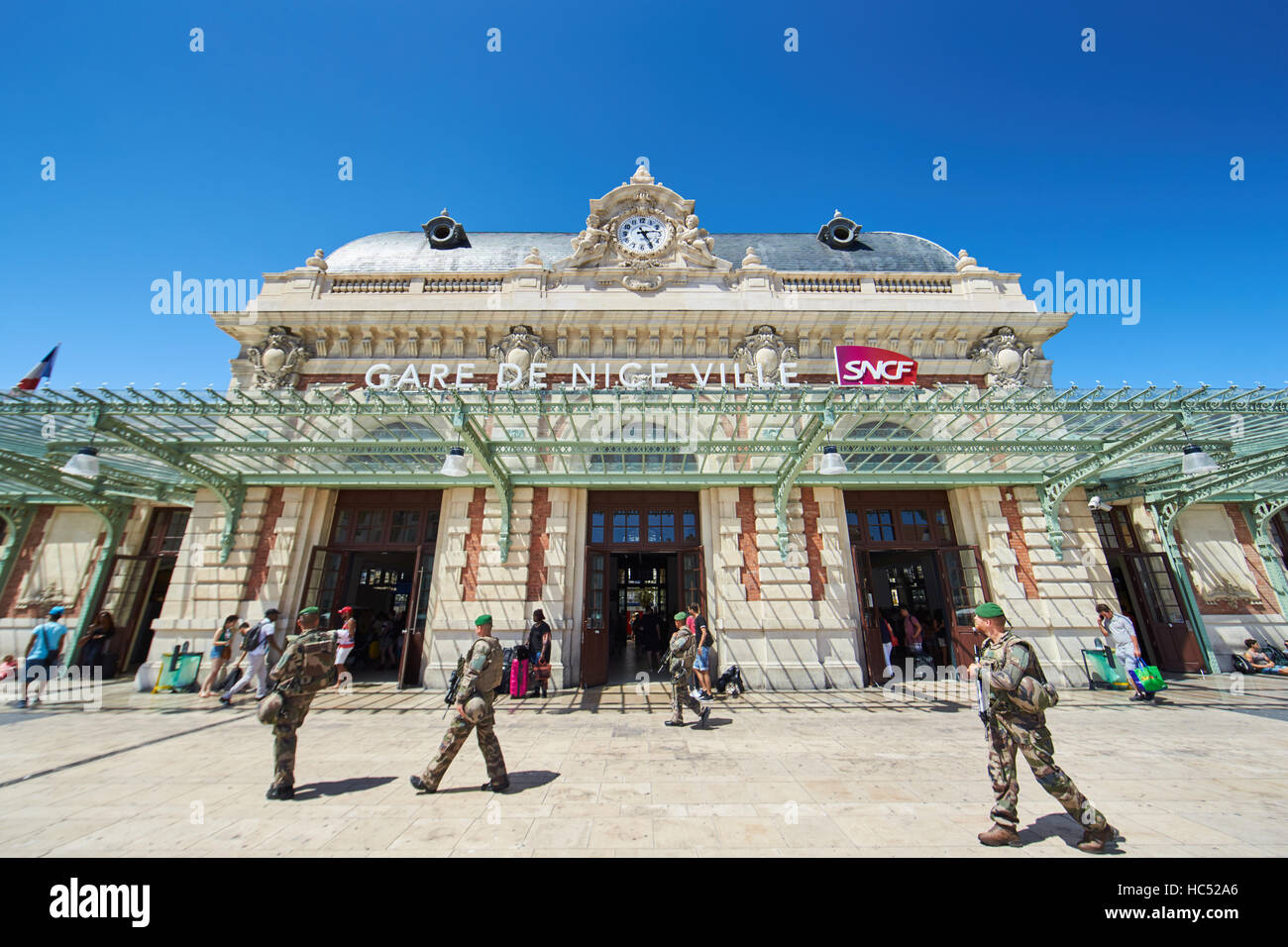 The French hired military patrol strategic important object railway station in the center, sunny day, blue sky, - Stock Image