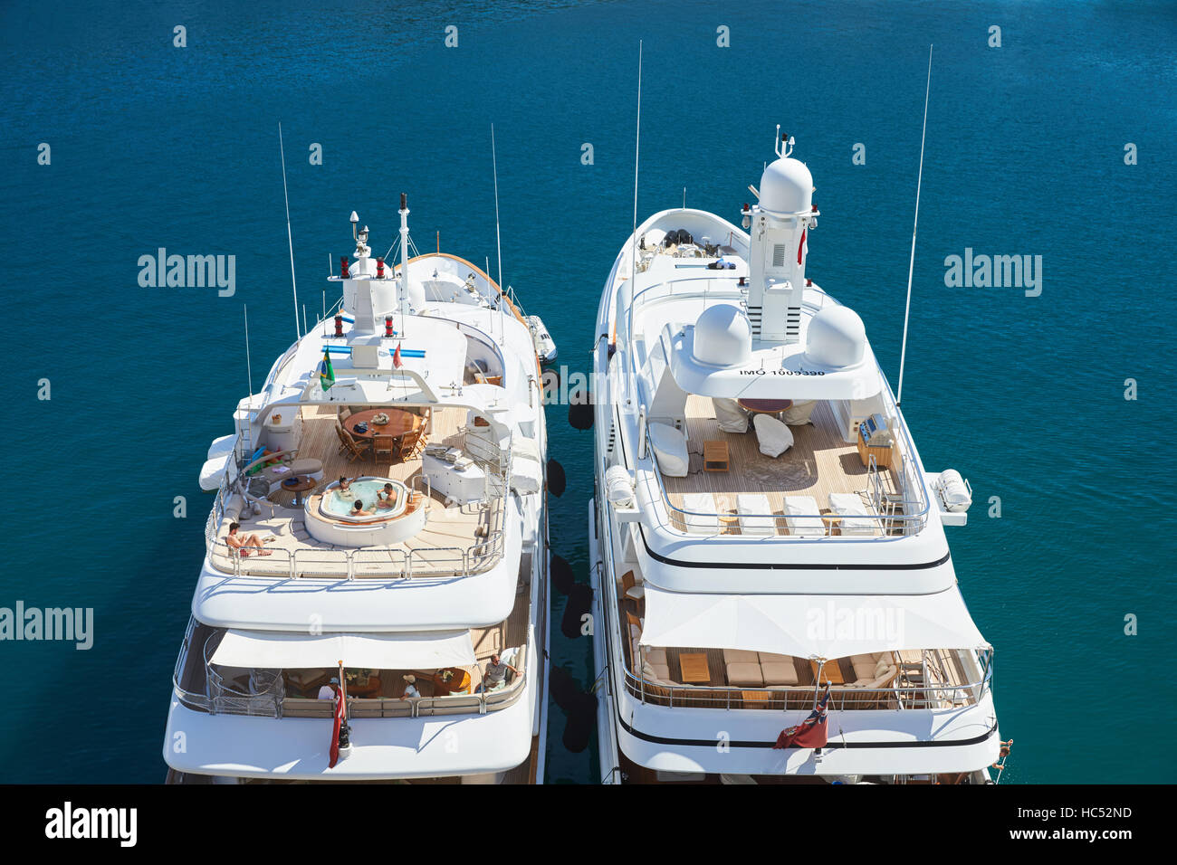 Port Hercules, People sunbathe on yachts, luxuriate in a jacuzzi on board the yacht, sunny day, megayachts - Stock Image