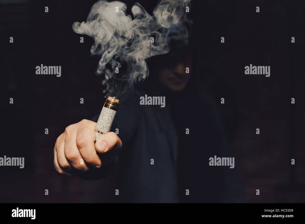 Man vaping an electronic cigarette - Stock Image