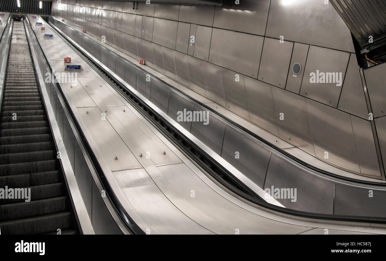 Empty escalator tube underground no adverts - Stock Image