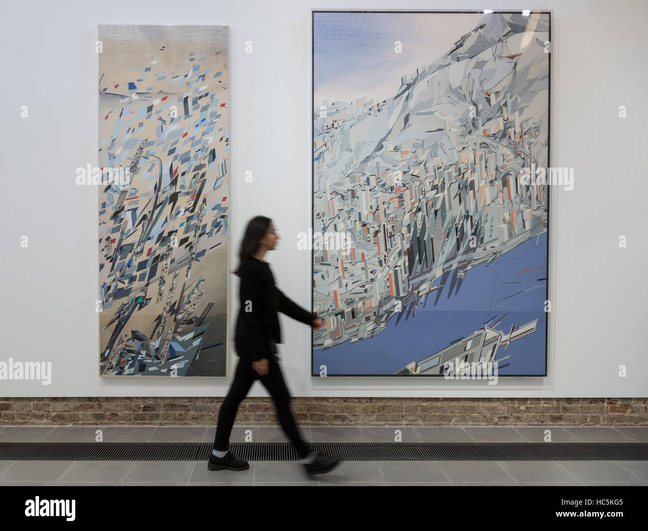 London, UK. 7 December 2016. A gallery assistant walks past the drawings Confetti: Suprematist Snowstorm, 1983, Stock Photo