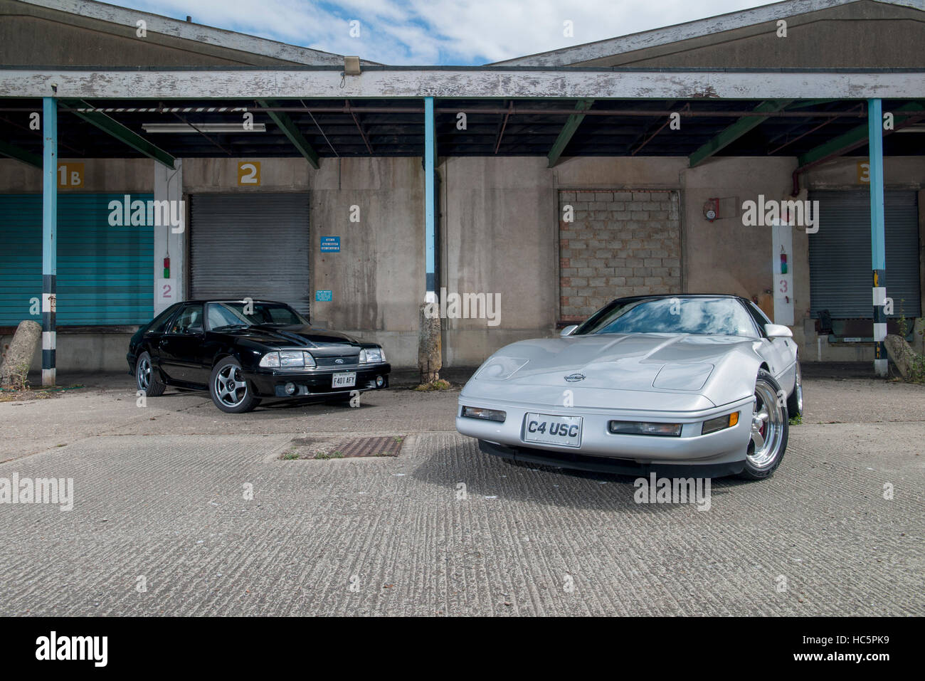 Rivals - Ford Mustang 'Fox' and C4 Corvette, 80s to 90s versions of the long time rival sports cars - Stock Image