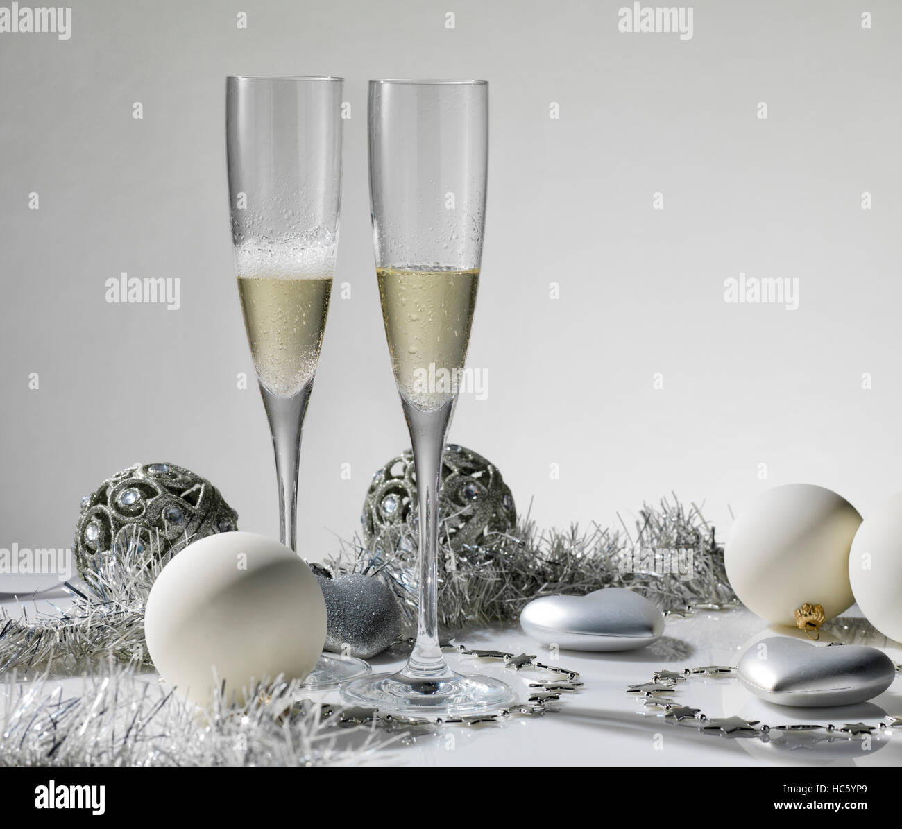 Champagne glasses ready to bring in the New Year - Stock Image