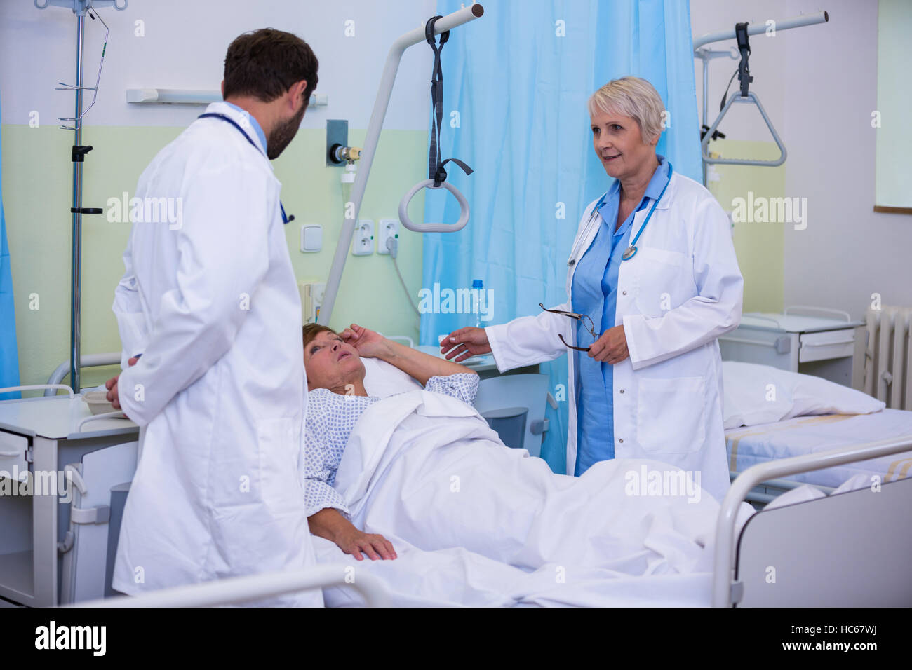 Doctors talking to a senior patient - Stock Image