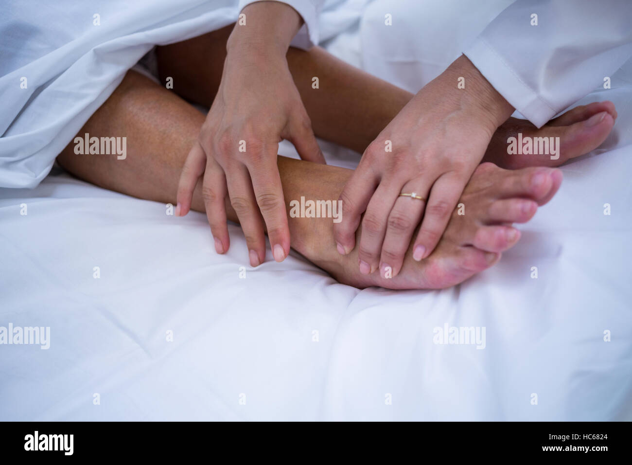 Doctor giving foot treatment to patient - Stock Image