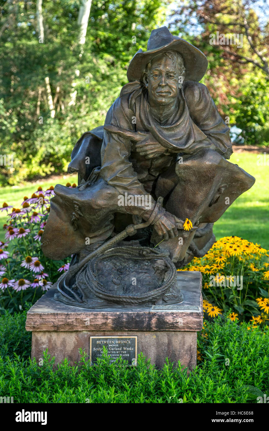 'Between Broncs' sculpture, by Garland Weeks, Benson Sculpture Garden, Loveland, Colorado USA - Stock Image