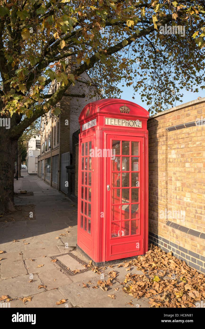 K2 Telephone Kiosk designed by Sir Gilbert Scott 1924, has Grade II Listed by English Heritage, on Agar Grove, Camden, - Stock Image