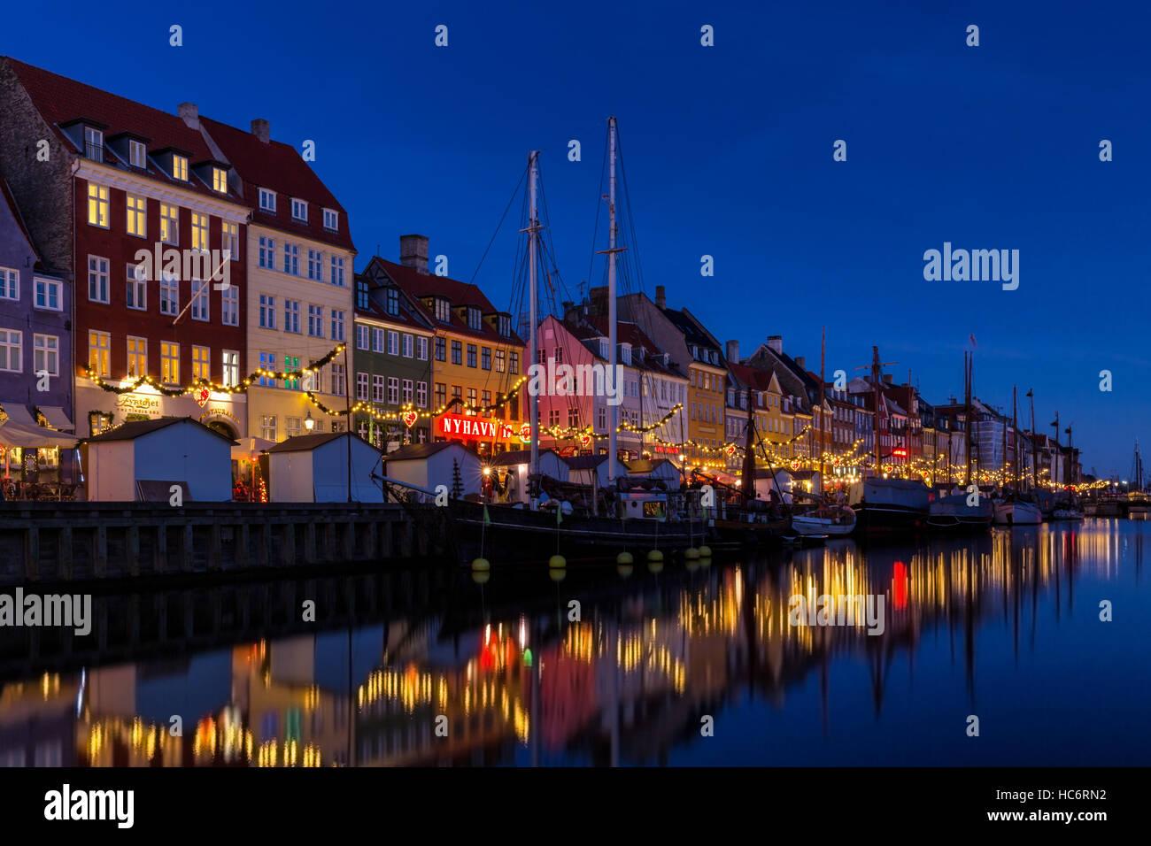 Christmas decoration along Nyhavn canal, Copenhagen, Denmark - Stock Image