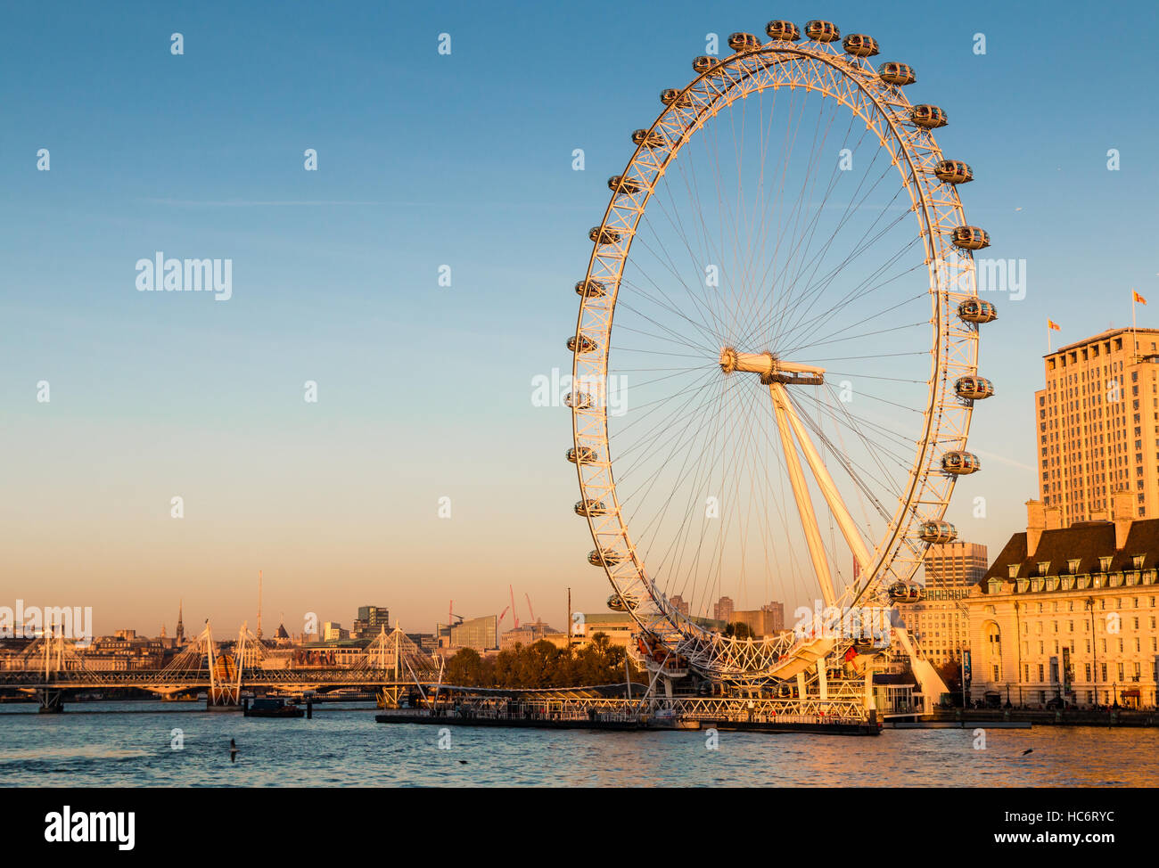 The London Eye and the London and River Thames skyline in afternoon winter sunlight.  The London Eye is set against Stock Photo