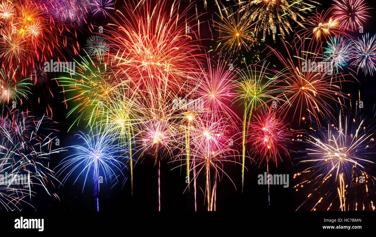 lively multi colored fireworks on black background ideal for new year party or any celebration event