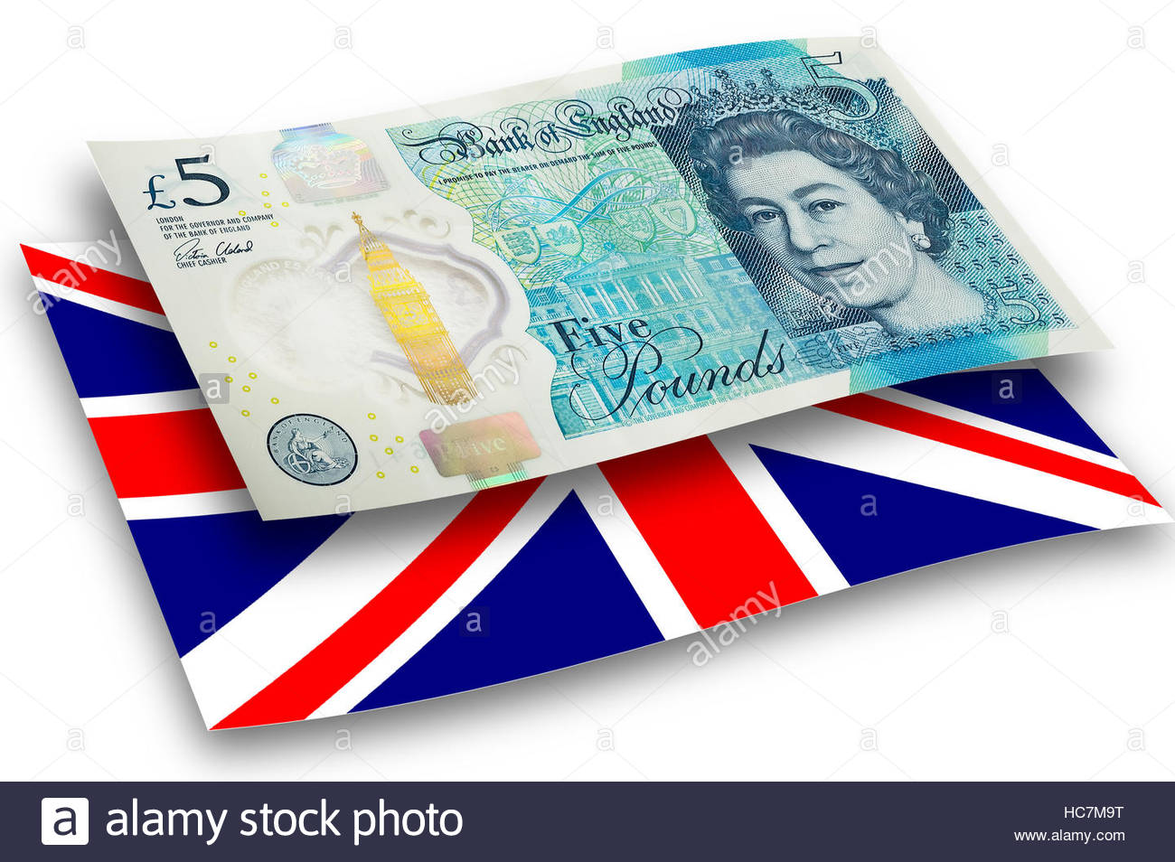 New five pound sterling note floating over the union jack. - Stock Image