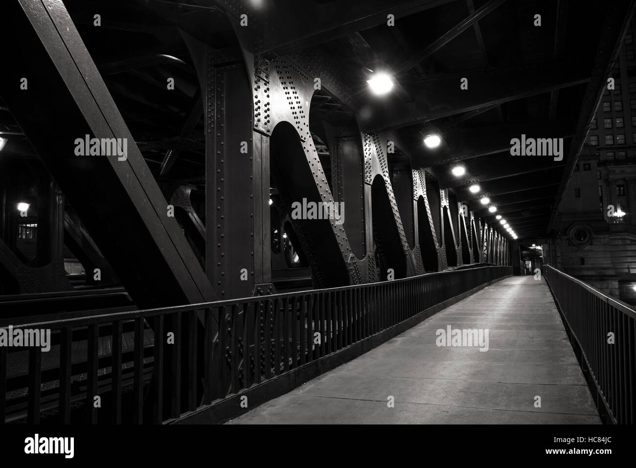 Night photograph of the lower Michigan Avenue Bridge (DuSable Bridge) as it crosses the river, Downtown Chicago, - Stock Image
