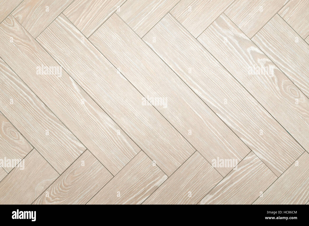 Beige floor tiles with look of parquet as a background - Stock Image