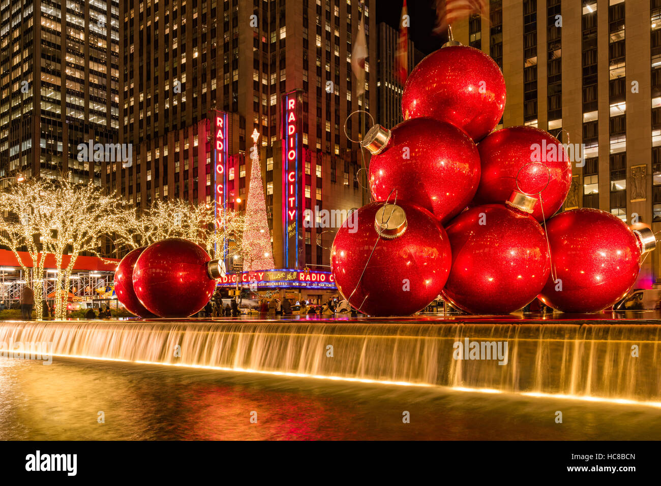 Giant red holiday ornaments on 6th Avenue. Christmas season Stock ...