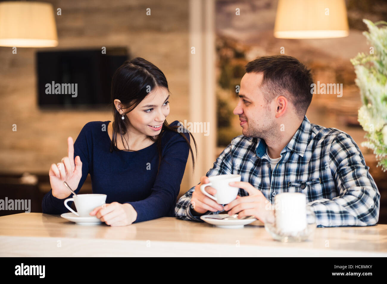 people, communication and dating concept - happy couple drinking tea at cafe - Stock Image