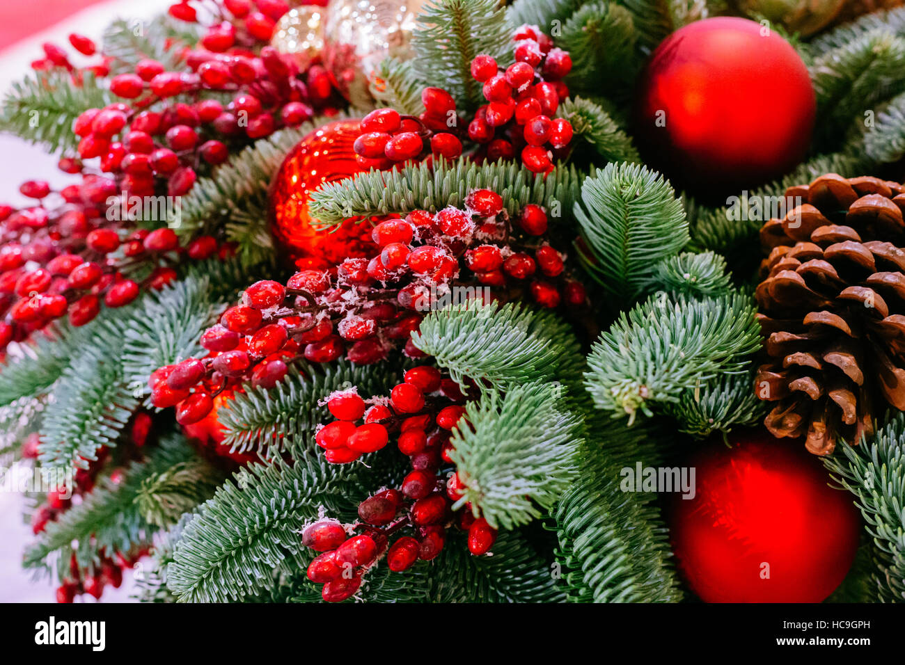 Christmas abstract background with red bauble decorations, mistletoe - Stock Image