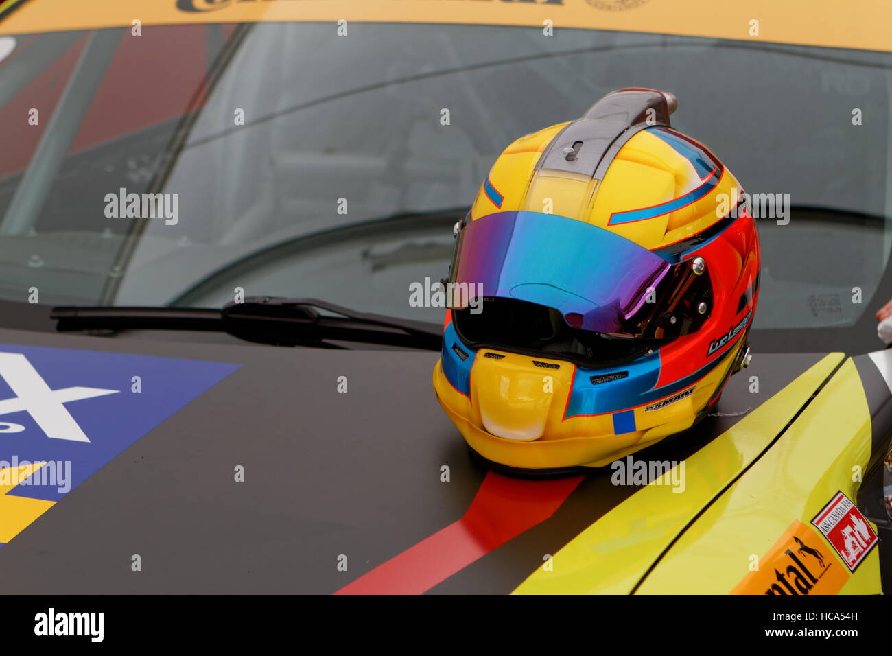 A race driver's helmet on the hood of a car ready to race in the CTCC, Canadian Touring Car Championship - Stock Image