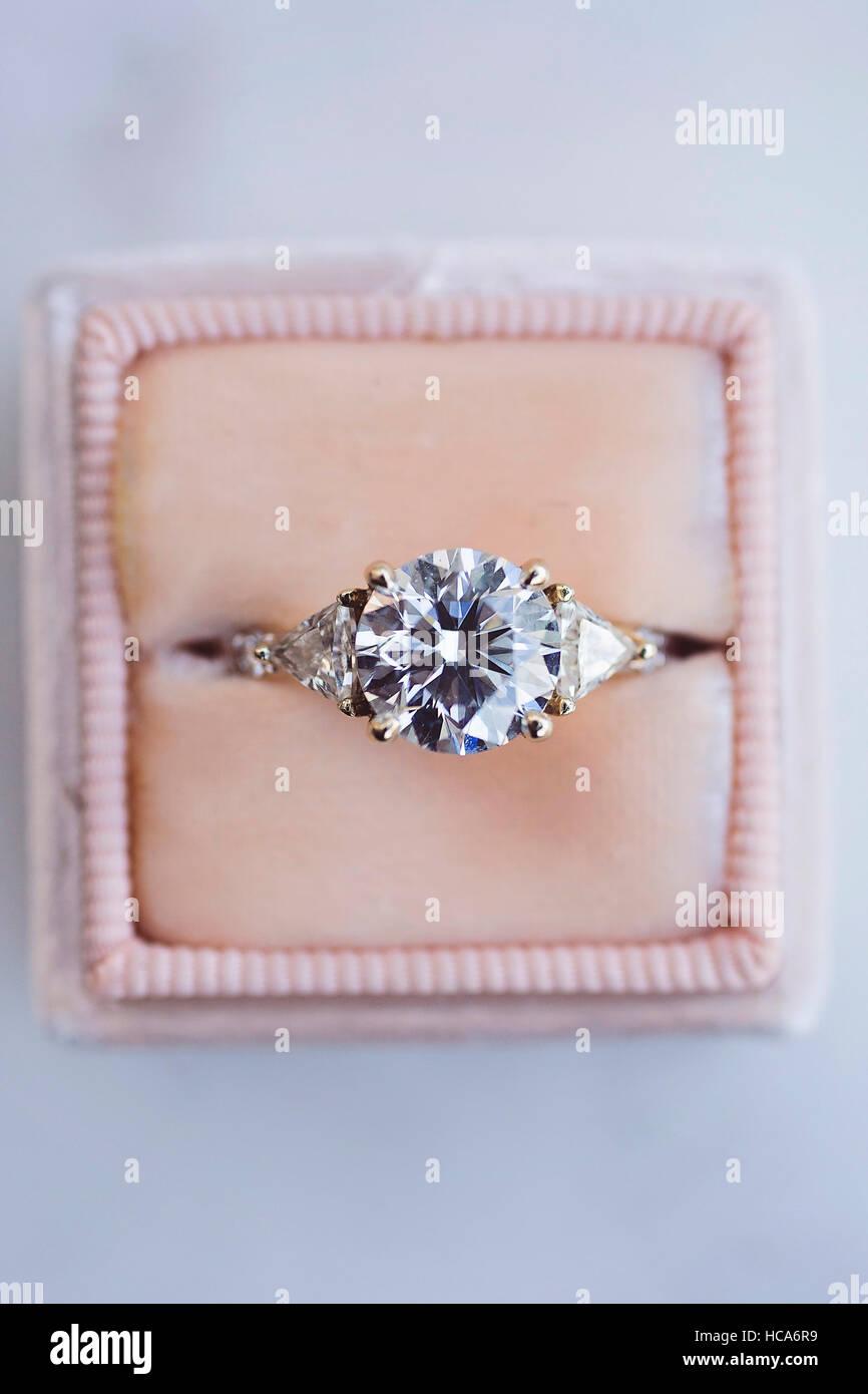 Diamond ring in cute pink box - Stock Image