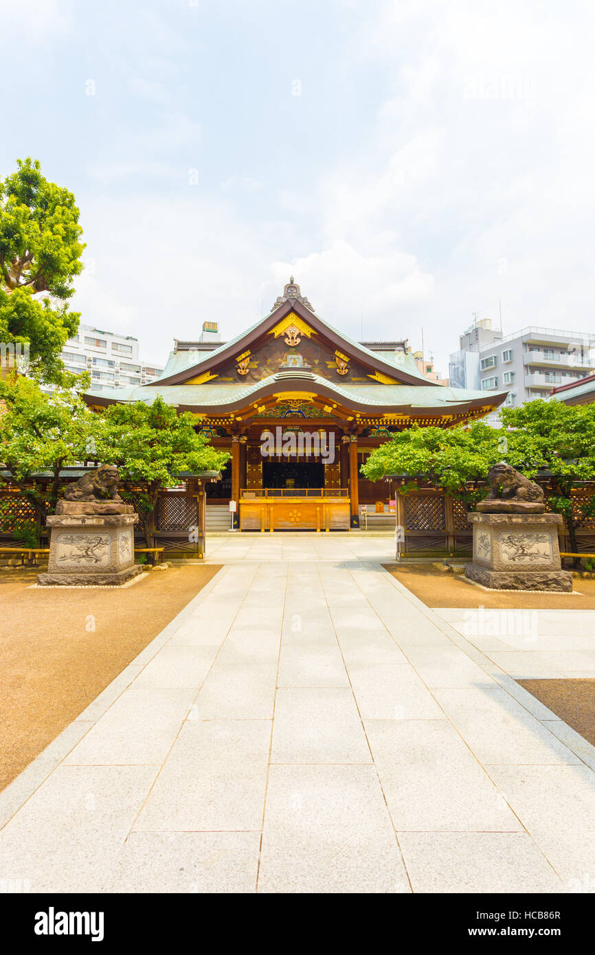 Centered front entrance to Yushima Tenman-Gu Shinto Shrine on a sunny summer day in Tokyo, Japan. Vertical - Stock Image
